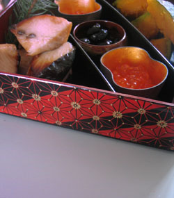 A selection of osechi-ryori displayed in a jubako (lacquer box)